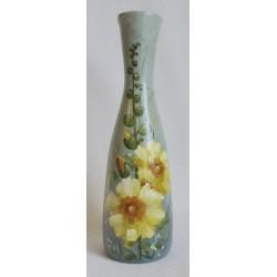 Vase décoratif fleurs jaunes sur fond gris